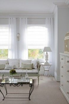 white on white - both sheer - roman blind and curtain
