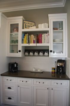 Coffee station, bronze counters in white kitchen