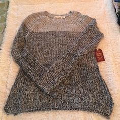 Girls oversized sweater - donating tomorrow Girls oversized sweater. New with tags. Labeled as a 12/14. Could easily fit a juniors xsmall. Faded Glory Tops