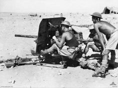 September 1941 - Australians of the 3rd Anti-tank Regiment behind one of their guns at Tobruk
