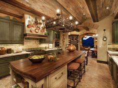 copper display and island counter top - maybe  -  makes you want to sit down and pour a vino...