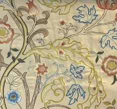 Mary Isobel Embroidered Fabric A beautiful embroidery of scrolling acanthus leaves and flowers, in russets, lime, blue and cream woven on a natural cloth.