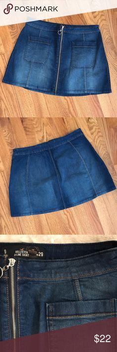 "NWOT Hollister Zip Front Denim Mini Skirt 9/29 Brand new. Never worn or washed. Stretch Denim.   Waist 32"". Hips 42"". Length 14"" Hollister Skirts Mini"