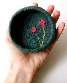 wool felted crocheted bowl. Now I gotta learn that too.