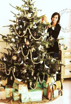 green christmas tree with white ornaments - Google Search