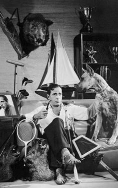 Bogart has so much time on his hands he can't decide which pastime to win more trophies in; boar hunting, tennis, golf, miniature yachting, archery, fishing, polo, smoking a pipe whilst gazing at self portraits or boar hunting.