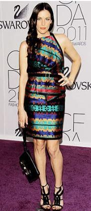 Who made Liv Tyler's stripe dress, sandals and purse that she wore to the 2011 CFDA Fashion Awards in New York? Shoes, purse and dress – Proenza Schouler
