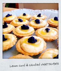 Lemon curd and candied violet tarts