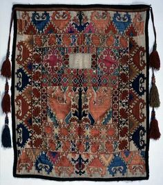 Tajik wedding face veil with heavily embroidered front, 19th c., Tajikistan Central Asia. The Russian Museum of Ethnography.