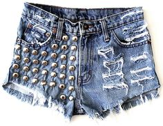 Reconstructed vintage tie dyed cut off denim shorts. High waisted with button up fly. Denim hand distressed, frayed, and shredded.