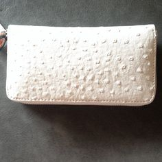 """HPSnob essentials zip around wallet NWT Off white snob essentials leather like wallet. 2 interior bill slots, 8 credit card slots and 1 center zip pocket. 7.5""""X4"""" Side to side top zipper. Keep everything safe in this wallet. Matches perfectly with the Vince Camuto cream laser cut sandals NWT PRICE FIRM Snob Essentials Bags Wallets"""