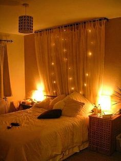 romantic bedroom lighting ideas - decorating canopy bed with lighted garlands