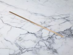 HOLLY HUNT, marble and brass