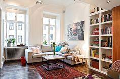 white walls + neutral furniture + persian rug