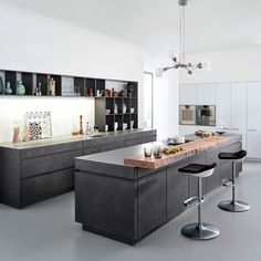 If a poured concrete kitchen seems like a bit too much of an undertaking, don't be despondent. Instead, you can mimic the look by coating your furniture in a thin layer of concrete, as seen in this design by Leicht for Connaught Kitchens. The finish is applied using a spatula and then protected with a matt satin lacquer. 'Manhattan' kitchen by Leicht, from £35,000, Connaught Kitchens (connaughtkitchens.co.uk)