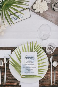Palm frond place setting for a destination wedding tablescape and reception.