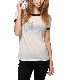 Superior comfort and quality style are fused with this ultra-soft feel ringer tee that features a slightly sheer cream body accented by navy banded hems and a reverse script graphic at the chest.