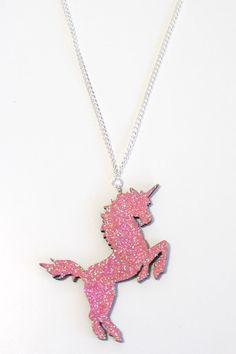"The Laser cut wooden Glitter Unicorn comes in pink or black. It measures approx 7cm from horn to back foot and is strung on to a sterling silver 18"" chain."