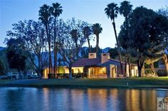 beautiful house on a golf course by the lake