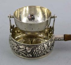Tea Strainer with Ornate Cup and Wood handle. A German sterling silver swivel tea strainer on a chased sterling cup with a wooden handle. Manufactured by Berthold Muller with London import marks for Tea Strainer, Tea Infuser, Hildesheimer Rose, Tea Art, Tea Caddy, Tea Service, Tea Accessories, Coffee Set, Vintage Tea