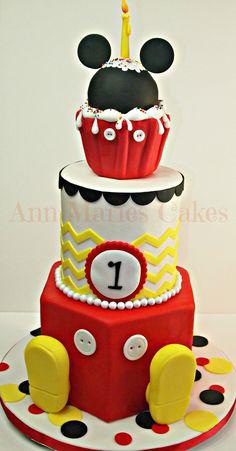 Mickey Mouse Chevron Mickey Mouse Chevron White Velvet cake, Vanillia Buttercream, Covered in fondant,Topper is RKT, Decor in fondant. I used Marvelous Molds...