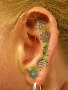 I like the idea of an ear tattoo but...A) OW! and B), ear skin turns over pretty fast, one wonders how long that ink would remain unfuzzy-looking. Must research.
