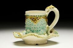 Demitasse Cup and Saucer | hand-built porcelain, incised, trailed slip, sprigs, stamps. By Claire Prenton.