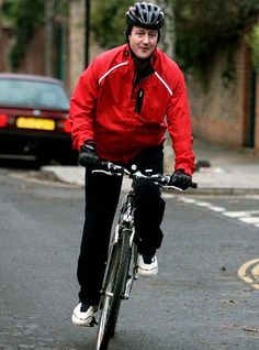Prime Minisiter David Cameron on a bicycle