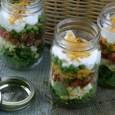 Great list of Fourth of July salad ideas. This photo shows Seven Layer Salad in a jar. Check out our super summer salad suggestions on Pocket Change Gourmet Mason Jar Meals, Meals In A Jar, Salad In A Jar, Soup And Salad, Fruit Salad, Cooking Recipes, Healthy Recipes, Jar Recipes, Recipies