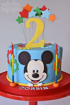Love the colors and that it's one tier! The gears match the cupcakes toppers and liners, too. Like Mickey or the clubhouse on it. Mickey Mouse Torte, Mickey And Minnie Cake, Bolo Mickey, Mickey Cakes, Mickey Party, Mickey Mouse Clubhouse Birthday Party, Minnie Birthday, 2nd Birthday, Birthday Ideas