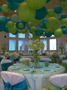 Aqua and lime wedding reception. The lanterns are so fun! Would do this with tangerine instead of green though.
