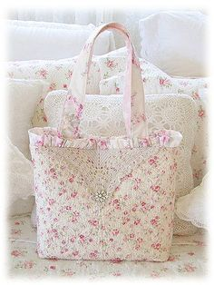 For this bag I used pretty pink quilted rosebuds, half a vintage crochet lace doily & a vintage rhinestone button.