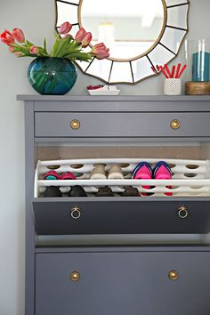 The ever-popular HEMNES shoe cabinet is a great solution for your entryway. Jen from iHeart Organizing painted her cabinet gray and added vintage-style ring drawer pulls for a customized look.