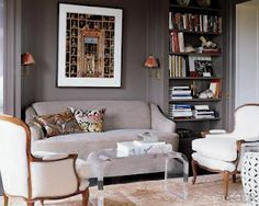 Bookcases flanking seating with sconces