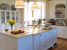 This casual island adds to the traditional charm of the kitchen and offers substantial space for everyday beverage and meal serving.