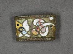 Russia. 17th-18th century. Copper alloy dagger fitting, band with cable border and enamel floral design.