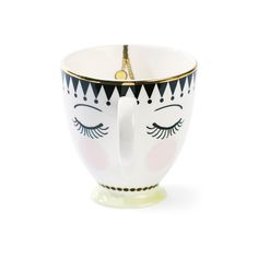 Enjoy warming beverages in charming style with this Eyes & Dots Ceramic…