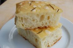 Focaccia..Fluffy, salty and redolent of aromatic olive oil and fresh rosemary.