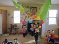 "New Year's Eve Balloon Drop. How fun! She did it for her kids' ""Noon Years Eve Party."" That's smart, too! That way kids get to join in on the fun, but are still in bed by their usual bedtime."