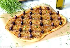 This caramelized onion and anchovy tart is a classic French dish that's great with white wine. #Pissaladière #FrenchCuisine #recipes
