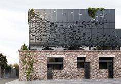 DKO | Carlton Home - Perforated Metal Skin - Light Well - Renovation - Adaptive Reuse