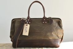 Charlie drab olive waxed canvas & dark brown leather bag. The quality is fantastic! I own one and LOVE it!
