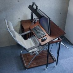 PC desk that can desk work on recliner chairs {sp} I need the table/desk/surface to move independently of the monitor