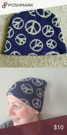 Navy Blue Peace Sign Knit Beanie Hat OSFM Cute Knit Beanie Hat. OSFM. Features cream colored peace sign with navy blue background. Warm and comfortable to wrest. Stretches very well. In great condition! No stains, rips, tears, or holes. Feel free to ask any questions. MAKE ME AN OFFER! FREE GIFT with every purchase! Bundle for further discounts. Boutique  Accessories Hats
