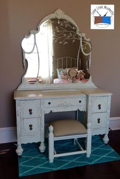 Painted vintage vanity with hand made stool made from pieces of a footboard