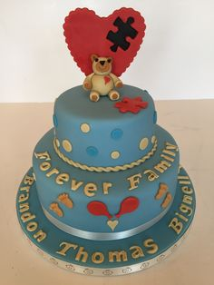 An ADOPTION CAKE - celebrating the missing piece to the family. The teddy looking after a jigsaw piece. Mar 2015.