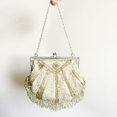 A personal favorite from my Etsy shop https://www.etsy.com/listing/258400687/antique-beaded-purse-bag
