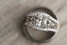 A vine-like engagement ring setting gets a modern update with curved pavé bands. The effect is simply entrancing!Photo Credit: Bethany Erin Photography