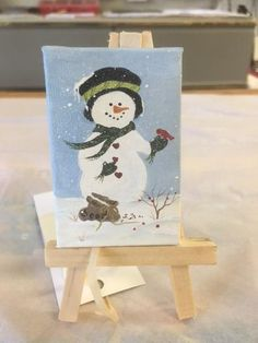 This cute little snowman, painted by Melody Mead, is sure to bring a smile to your face. Melody is a multi-talented artist and has many types of artwork available at the shop.