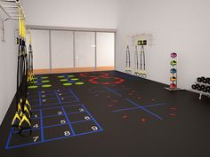"What do you think about converting a racquetball court into a functional training or small group trainer area? This image shows the wood floor covered in budget rubber flooring and ""do-it-yourself"" added stickers to the floor. I wonder if there is a better way of doing this?"